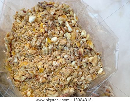Chicken feed with broken maize in a small plastic bag