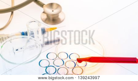 laboratory test tubes,medical glassware , Stethoscope,plastic syringe  ( Filtered image processed colorful effect. )