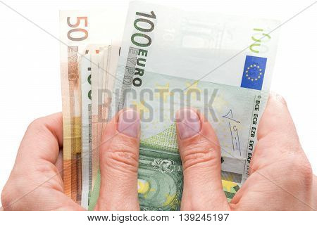 Euros in the hands isolated on a white background