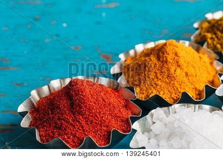 Wooden table of colorful spices. Spices and herbs