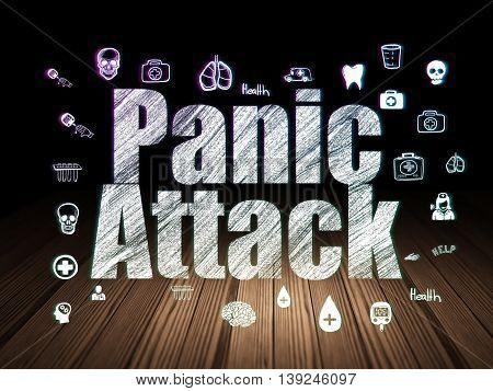 Medicine concept: Glowing text Panic Attack,  Hand Drawn Medicine Icons in grunge dark room with Wooden Floor, black background