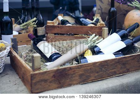 Wine bottles in wooden boxes. Shallow depth of field. Horizontal. Toned
