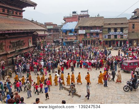 Bhaktapur Nepal - April 05 2014: A large crowd on the street festival in Bhaktapur Durbar square in Nepal.