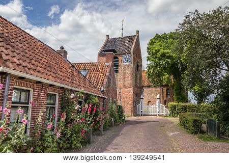 Central street and church tower of Ezinge Netherlands
