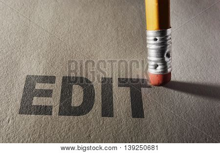 Edit text being erased by a pencil -- proofreading and editing concept