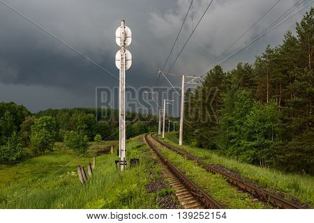 Railway in the forest after the rain