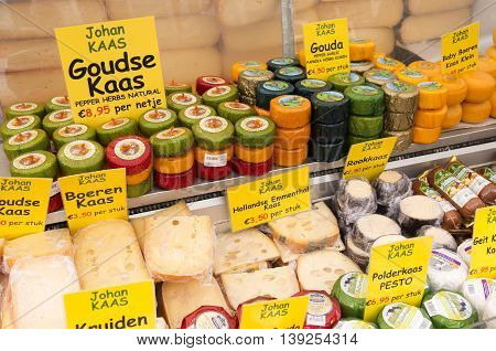 NETHERLANDS - AMSTERDAM - CIRCA MARCH 2014: Market stall with cheese on the Albert Cuyp market in Amsterdam Netherlands.