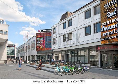 LAPPEENRANTA, FINLAND - JUNE 15, 2016: People on pedestrian zone near IsoKristiina Shopping Center. Brahenkatu Street