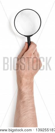 Hand of a man holding magnifying glass isolated on white background. Close-up view. Optical magnification. Searching and analyzing.