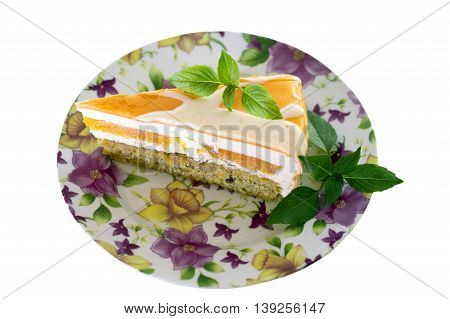 cake with orange frosting and mint on white background