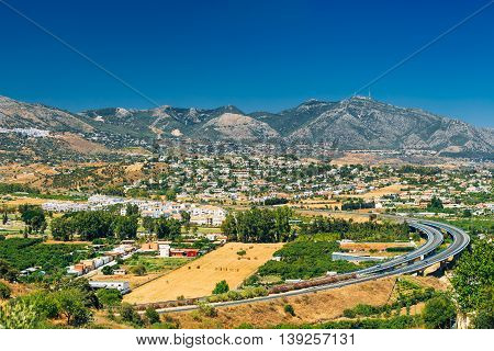Panoramic View Of Mijas in Malaga, Andalusia, Spain. Summer Panorama Cityscape With Motorway, Highway