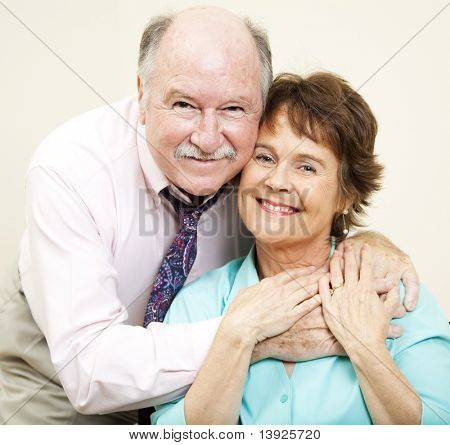 Loving portrait of good looking couple in their early sixties.