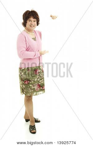 Humorous female impersonator holding blank white space.  Full body isolated on white.