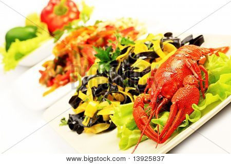 Food theme: tasty colorful pasta dish with boiled lobsters.