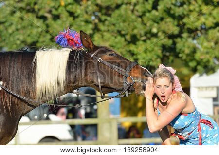IPSWICH SUFFOLK UK 25 October 2014: East Anglia Equestrian Fair shocked girl listening to talking horse