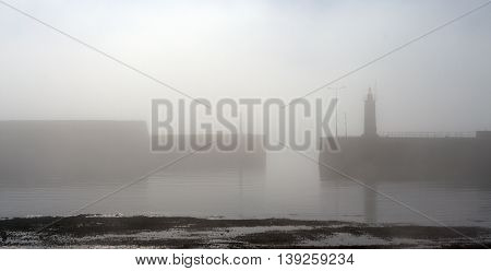 Anstruther Harbour  in Fife, Scotland as the mist rises on a warm autumn day 2015.