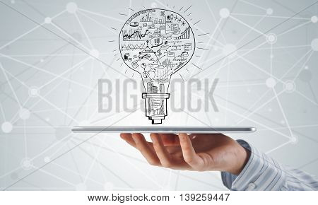 Close view of businessman presenting his business plan on tablet screen