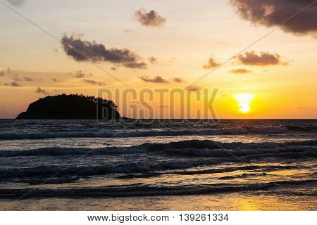 Seascape sunset with color of sunlight and storm cloud sky on the sand beach in twilight