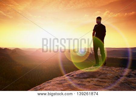 Thinking Hiker In Black On Rocky Peak. Wonderful Daybreak. Ginger Hair Man