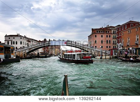 Houses over the channel and bridge. Venice