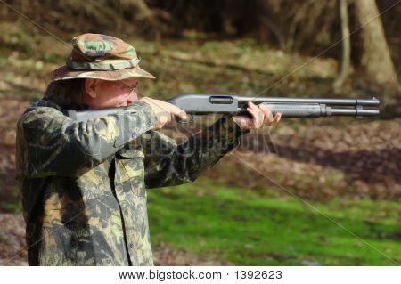 Man With Shotgun Taking Aim