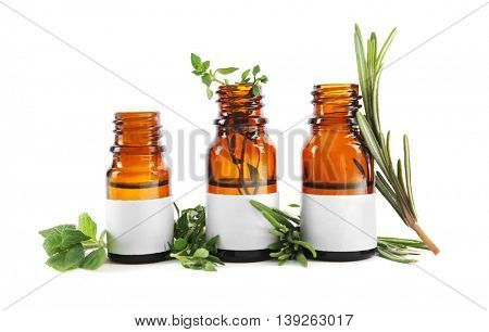 Dropper bottles and herbs isolated on white