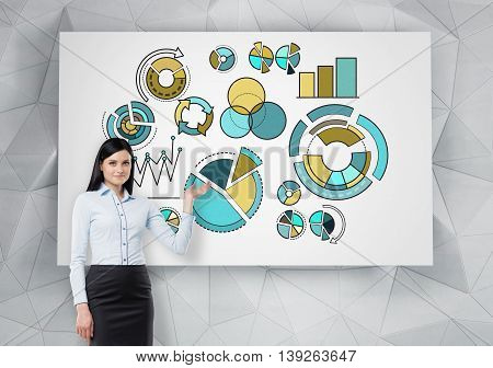 Businesswoman delivering presentation with business pie charts drawn on whiteboard hanging on abstract patterned wall