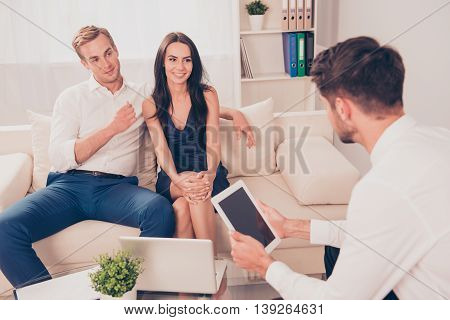 Young Happy Couple At Meeting With Agent