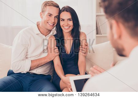 Young Happy Couple On Reception For Family Psychologist