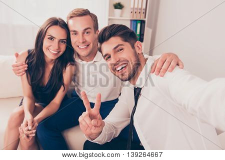 Young Smiling Friends In Formalwear Take Selfie Picture On Camera