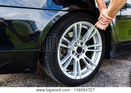 Car wheel changed by Wrench on the road while a trip