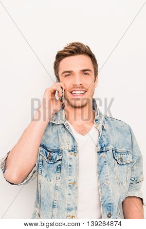 Portrait Of Happy Cheerful Man In Jeans Jacket Talking On Phone