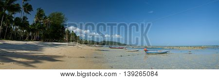 Beach on Ko Samui, Thailand with boat and palms