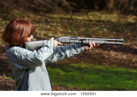 Woman With A Shotgun