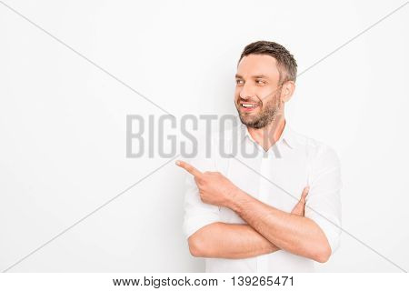 Handsome Bearded Businessman Gesturing With Finger Showing Direction