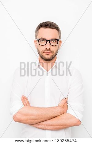 Portrait Of Confident Successful Man In Spectacles And White Shirt  With Crossed Hands