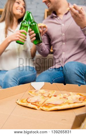 Happy Couple In Love Spending Holiday With Pizza And Beer