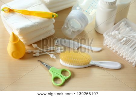 Baby accessories for hygiene on wooden background