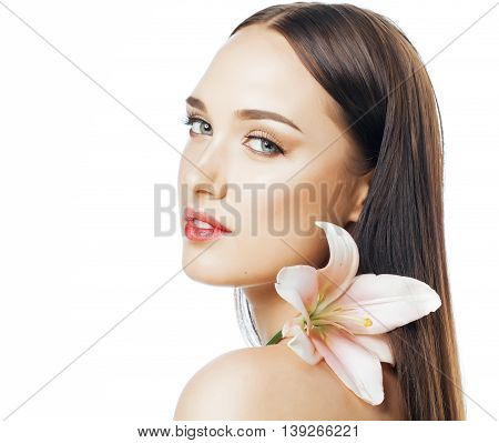 young attractive lady close up with hands on face isolated flower lily brunette spa nude makeup, beauty concept
