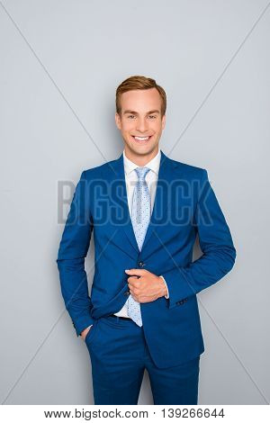 Portrait Of Handsome Young Businessman Buttoning His Jacket
