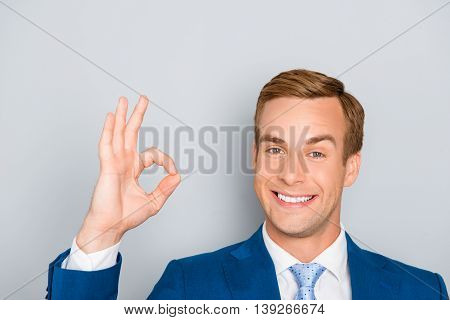 Happy Handsome Smiling Successful Businessman Gesturing
