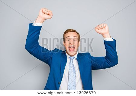 Portrait Of Happy Businessman Celebrating Victory With Raised Hands