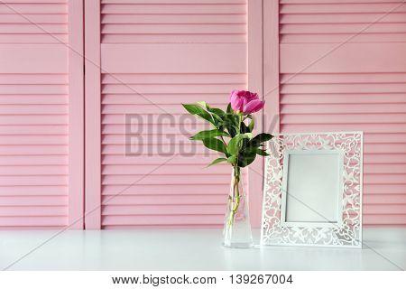 Beautiful peony flower on pink folding screen background