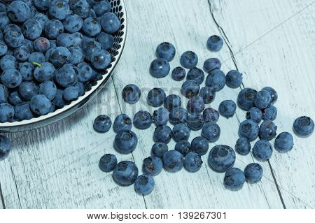 Freshly picked blueberries. Bilberry on wooden Background. Blueberry antioxidant. Concept for healthy eating and nutrition