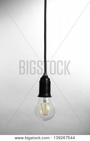 Light bulb on light background