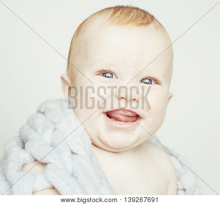 little cute red head baby boy in scarf all over him close up isolated, adorable kid