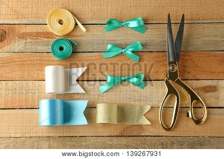 Sewing creative accessories on wooden background, top view