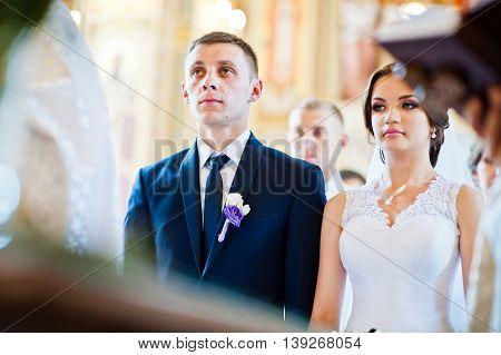 Wedding couple at church registration  at wedding