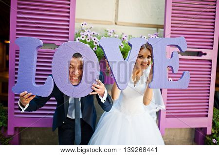 Newlywed With Decor Violet Word Love Background Purple Wooden Window