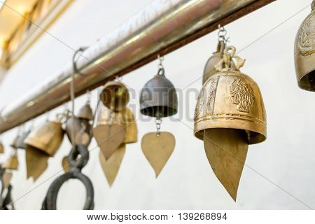 Row of Thai style bells in buddhist temple. Golden Mount temple Bangkok Thailand.